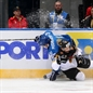 MINSK, BELARUS - MAY 10: Germany's Sinan Akdag #82 and Kazakhstan's Konstantin Pushkaryov #81 get tangled up along the board battling for the puck during preliminary round action at the 2014 IIHF Ice Hockey World Championship. (Photo by Andre Ringuette/HHOF-IIHF Images)