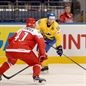 MINSK, BELARUS - MAY 10: Sweden's Linus Klasen #86 looks for a pass with pressure from Denmark's Jesper B. Jensen #41 during preliminary round action at the 2014 IIHF Ice Hockey World Championship. (Photo by Richard Wolowicz/HHOF-IIHF Images)