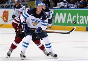 MINSK, BELARUS - MAY 10: Finland's Jori Lehtera #21 chips the puck forward during preliminary round action against Latvia at the 2014 IIHF Ice Hockey World Championship. (Photo by Andre Ringuette/HHOF-IIHF Images)