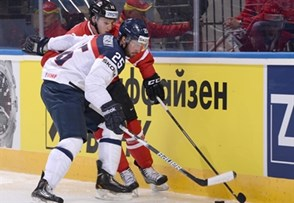 MINSK, BELARUS - MAY 10: Canada's Nathan MacKinnon #29 and Slovakia's Marek Viedensky #25 battle for the puck along the boards during preliminary round action at the 2014 IIHF Ice Hockey World Championship. (Photo by Richard Wolowicz/HHOF-IIHF Images)