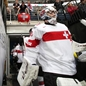 MINSK, BELARUS - MAY 10: Switzerland's Reto Berra #20 leads his team to the ice for preliminary round action against the U.S. at the 2014 IIHF Ice Hockey World Championship. (Photo by Andre Ringuette/HHOF-IIHF Images)