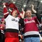 MINSK, BELARUS - MAY 11: Latvian fans cheering on their team against Germany during preliminary round action at the 2014 IIHF Ice Hockey World Championship. (Photo by Andre Ringuette/HHOF-IIHF Images)