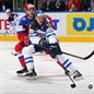 MINSK, BELARUS - MAY 11: Finland's Olli Jokinen #12 reaches for the puck while Russia's Nikolai Kulyomin #41 defends during preliminary round action at the 2014 IIHF Ice Hockey World Championship. (Photo by Andre Ringuette/HHOF-IIHF Images)