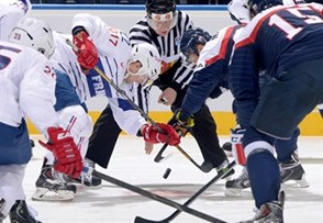 MINSK, BELARUS - MAY 12: France's Brian Henderson #22 faces off against Slovakia's Ladislav Nagy #27 during preliminary round action at the 2014 IIHF Ice Hockey World Championship. (Photo by Richard Wolowicz/HHOF-IIHF Images)