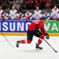 MINSK, BELARUS - MAY 11: Switzerland's Reto Schappi #19 on a breakaway as Belarus' Roman Graborenko #92 chases him down during preliminary round action at the 2014 IIHF Ice Hockey World Championship. (Photo by Andre Ringuette/HHOF-IIHF Images)