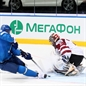 MINSK, BELARUS - MAY 13: Latvia's Edgars Masalskis #31 makes the save on  Kazakhstan's Roman Starchenko #48 during preliminary round action at the 2014 IIHF Ice Hockey World Championship. (Photo by Andre Ringuette/HHOF-IIHF Images)