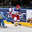 MINSK, BELARUS - MAY 14: Russia's Sergei Shirokov #52 skates with the puck while Kazakhstan's Roman Starchenko #48 defends during preliminary round action at the 2014 IIHF Ice Hockey World Championship. (Photo by Andre Ringuette/HHOF-IIHF Images)