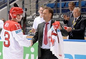 MINSK, BELARUS - MAY 15: Denmark's Morten Green #13 is presented with a jersey for playing his 257th game for Team Denmark during preliminary round action at the 2014 IIHF Ice Hockey World Championship. (Photo by Richard Wolowicz/HHOF-IIHF Images)