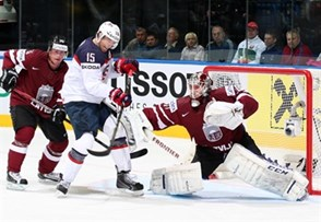 MINSK, BELARUS - MAY 15: USA's Craig Smith #15 with a scoring chance against Latvia's Kristers Gudlevskis #50 while Jekabs Redlihs #14 looks on during preliminary round action at the 2014 IIHF Ice Hockey World Championship. (Photo by Andre Ringuette/HHOF-IIHF Images)