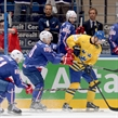 MINSK, BELARUS - MAY 15: Sweden's Dick Axelsson #28 pulls the puck away from France's Teddy Da Costa #80 during preliminary round action at the 2014 IIHF Ice Hockey World Championship. (Photo by Richard Wolowicz/HHOF-IIHF Images)