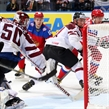 MINSK, BELARUS - MAY 17: Russia's Sergei Shirokov #52 scores a goal against Latvia's Kristers Gudlevskis #50 while Georgijs Pujacs #81 looks on during preliminary round action at the 2014 IIHF Ice Hockey World Championship. (Photo by Andre Ringuette/HHOF-IIHF Images)