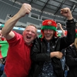 MINSK, BELARUS - MAY 17: Belarus fans cheering on their team during preliminary round action against Germany at the 2014 IIHF Ice Hockey World Championship. (Photo by Andre Ringuette/HHOF-IIHF Images)
