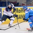 MINSK, BELARUS - MAY 17: Slovakia's Juraj Mikus #71 pulls the puck away from Italy's Christian Borgatello #50 during preliminary round action at the 2014 IIHF Ice Hockey World Championship. (Photo by Richard Wolowicz/HHOF-IIHF Images)