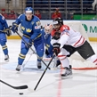 MINSK, BELARUS - MAY 18: Canada's Joel Ward #42 reaches for the puck in front of Sweden's Erik Gustafsson #29 during preliminary round action at the 2014 IIHF Ice Hockey World Championship. (Photo by Richard Wolowicz/HHOF-IIHF Images)