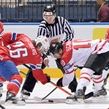 MINSK, BELARUS - MAY 20: Norway's Kristian Forsberg #26 faces off against Canada's Brayden Schenn #10 during preliminary round action at the 2014 IIHF Ice Hockey World Championship. (Photo by Richard Wolowicz/HHOF-IIHF Images)