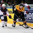 MINSK, BELARUS - MAY 20: Germany's Frank Hordler #48 plays the puck while USA's Brock Nelson #11 and Craig Smith #15 defend during preliminary round action at the 2014 IIHF Ice Hockey World Championship. (Photo by Andre Ringuette/HHOF-IIHF Images)