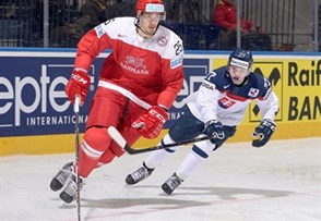 MINSK, BELARUS - MAY 20: Denmark's Oliver Lauridsen #25 stickhandles the puck with  Slovakia's Martin Reway #77 chasing during preliminary round action at the 2014 IIHF Ice Hockey World Championship. (Photo by Richard Wolowicz/HHOF-IIHF Images)