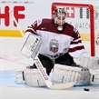 MINSK, BELARUS - MAY 20: Latvia's Kristers Gudlevskis #50 goes down to make the save during preliminary round action against Switzerland at the 2014 IIHF Ice Hockey World Championship. (Photo by Andre Ringuette/HHOF-IIHF Images)