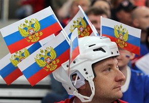MINSK, BELARUS - MAY 24: A Russian cheering on his team during semifinal round action against Sweden at the 2014 IIHF Ice Hockey World Championship. (Photo by Andre Ringuette/HHOF-IIHF Images)