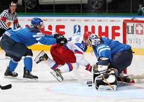 MINSK, BELARUS - MAY 25: Russia's Sergei Shirokov #52 with a scoring chance against Finland's Pekka Rinne #35 while Tommi Kivisto #6 defends during gold medal game action at the 2014 IIHF Ice Hockey World Championship. (Photo by Andre Ringuette/HHOF-IIHF Images)